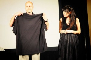 Presenter Kevin Miller gets wardrobe assistance from an aghast Cheryl Wicker at the 2011 ICVM Crown Awards